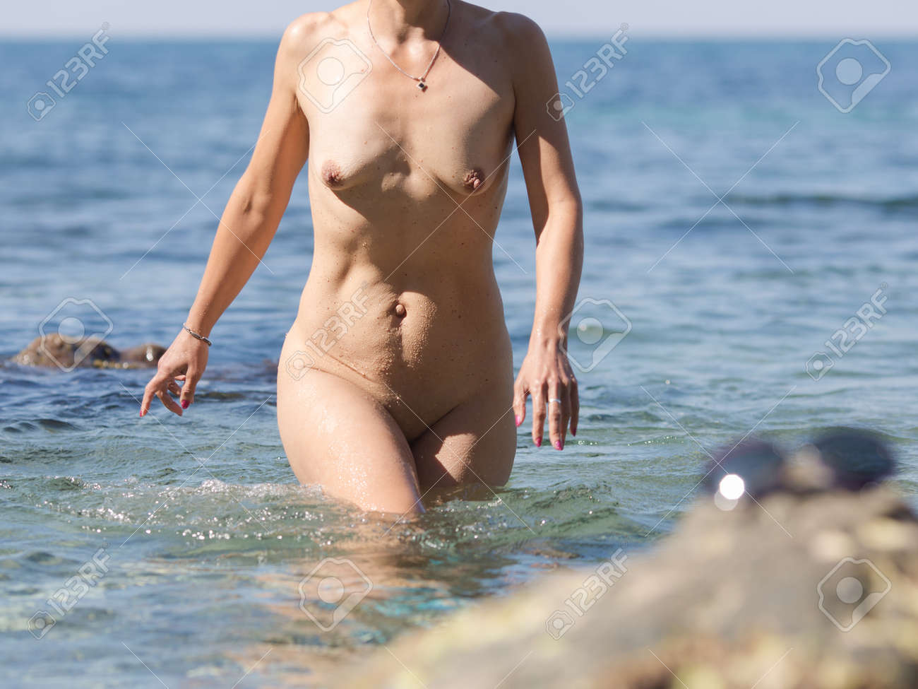 Girl coming out of water naked
