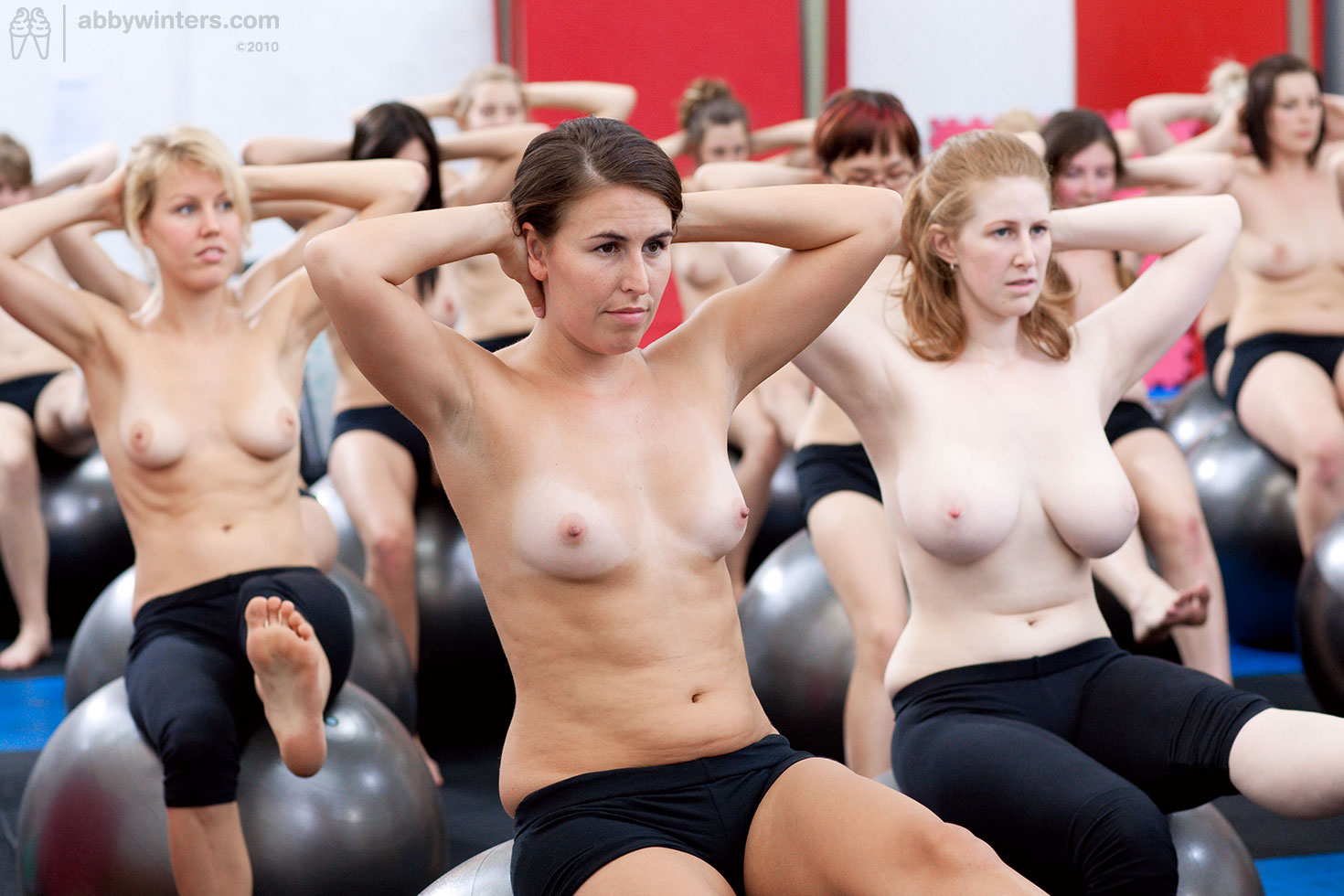 Group of naked girls working out