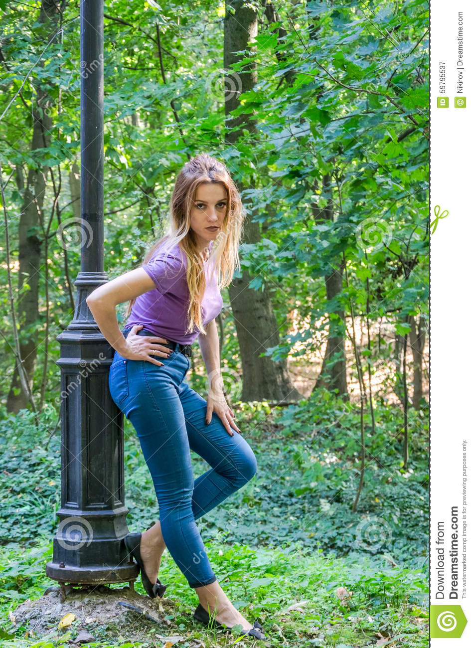 Sexy girl posing in the trees